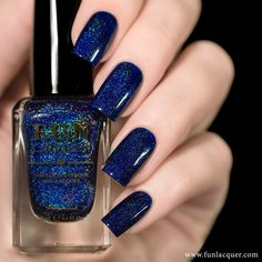 Here's a navy blue nail polish with an iridescent shimmer to paint your nails…