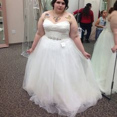 Plus Size Lace and Tulle Wedding Dress Stunning lace and tulle, empire waist wedding dress from David's Bridal. Only worn once for a couple of hours for a museum event. The train got a bit dusty, but wouldn't be noticeable walking down the aisle. Size 20 and fits true to size. Corset back. Sweetheart neckline. Any questions, please ask. David's Bridal Dresses Wedding