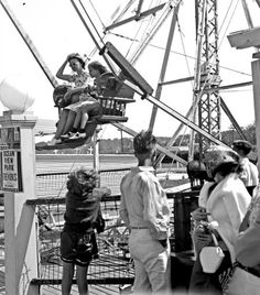 People enjoying a ride at the Ocean View Amusement Park during the Fourth of July holiday - Norfolk, Virginia. (Date: 7/4/1938).