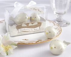 Treat your baby shower guests to our Feathering the Nest Bird Salt and Pepper Shakers. A loving mother bird and smaller baby bird, both endearingly designed from beak to tail, bring a very special feel to this baby shower thank-you gift.