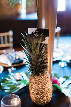 This glam gold and black tropical wedding is filled with exotic elegance. It's an indoor tropical paradise of palm trees, exotic flowers and striking gold details with pops of teal and fuchsia. City Wedding Themes, Tall Gold Vases, Tropical Wedding Reception, Party City Balloons, Bridal Party Tables, Exotic Flowers, Tropical Paradise, Palm Trees, Banquet Ideas