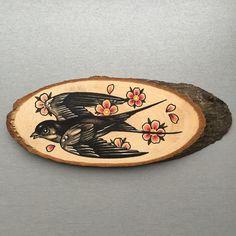 Wood slice with an original drawing of a sparrow door Inkspirednl