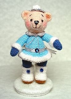 Miss Winterbeary is all dressed for winter fun in her little dress, tights, boots, and cap! Can't you just picture her at the ice skating pond? The Winterbeary pattern makes an adorable 3-inch bear when you use punch thread or fine mohair and a size 12 hook. The bear will be about 5 inches if you use a sport-weight mohair yarn and a size 7 hook (as in the last two photos).