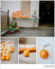 Best idea I've ever seen for wedding place cards! Oranges!