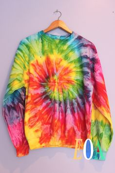 Bright rainbow tie dyed swirl crew neck sweatshirt. Made from 80% cotton and 20% polyester. Since each sweatshirt is hand-dyed, color blending will vary slightly making each one unique. Washing instru