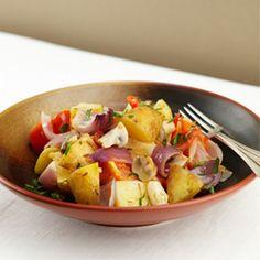 Ovenschotel met aardappeltjes, champignons, tomaten en chili