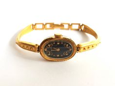 Awesome Gold vintage watch made in 80s.  Gold Soviet Vintage Watch Mechanical Luch with awesome yellow dial. Watch in great new condition. Works