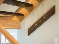 Very cute coat rack made from old rafter and old metal pieces. Love how it's hung on an angle.  Blog Cabin 2013: Entryway Pictures : Blog Cabin : DIY Network