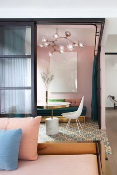 Swathes of bright colour combine with patterned ceramic tiles in the Hong Kong apartment home of multidisciplinary design studio Lim + Lu.