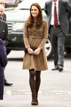 February 21, 2012Middleton balances her Orla Kiely coat with brown opaque tights and ankle boots at the Oxford Spires Academy School in Oxford, England.