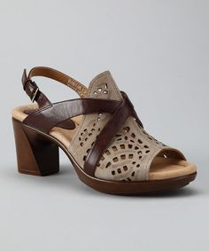 Wrap trendy toes in wellness with this posh pair of luxurious leather sandals. The footbed features multi-density latex cushioning for extra comfort while the reinforced arch and padded heel help absorb and displace shock while improving posture.