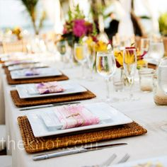Long banquet tables with square chargers and plates brought a contemporary feel to the tables. (From TheKnot.com)