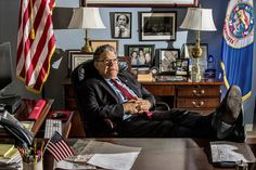Senator Al Franken in his D.C. office, late 2016. Note photos featuring Paul Wellstone in background.