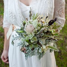 Eclectic mix of pussy willows, lisianthus, fiddlehead ferns, dusty miller and cherry blossoms. and i like the dress! Wedding Dress Suit, Perfect Wedding Dress, Wedding Dress Styles, Flower Bouquet Wedding, Bridesmaid Bouquet, Wedding Bridesmaids, Bridal Bouquets, Top Wedding Dress Designers, Woodland Wedding Inspiration