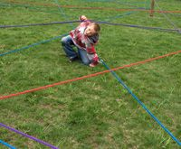 Rope Maze- hook a d-ring to a colored rope and move it to the start of the rope. Have kids hold onto the ring and try to find their way through the maze. crawl up down, over and under to find your way to the end of the maze.