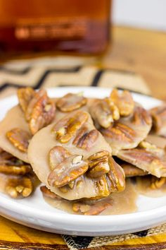 """Take classic pralines to a whole new level with these Bourbon Pecan Pralines! New Orleans is famous for its pralines, and I remember trying some from a street vendor down there. Of course they were amazing. Easy Desserts, Delicious Desserts, Yummy Food, Tasty, Candy Recipes, Dessert Recipes, Baking Recipes, Praline Recipe, Stuffed Grape Leaves"