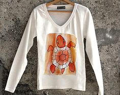 Hand painted turtle t shirt in orange and white. Artistic t shirt with long sleeves suitable for autumn. Sea design t shirt.
