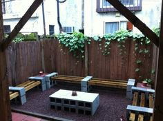 Seating: cinder blocks + 2x2s create plenty of seating for a backyard BBQ, complete with cinderblock table