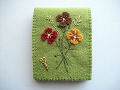 Green Needle Book with Hand Embroidered Felt Flowers and Brass Scissors Charm. $24.00, via Etsy.