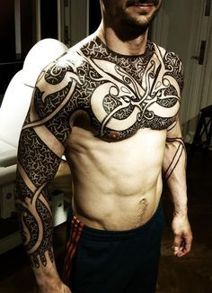 Viking Tattoo. I'd totally draw this on him. Payback for the battleaxe on my back xD