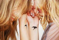 swallow tattoo on wrist