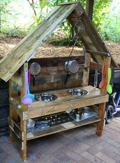 Mud Kitchen made from wood with a roof