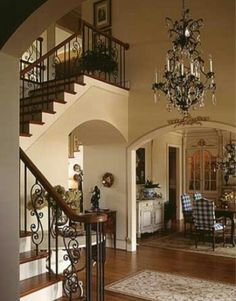 Gorgeous banister and chandelier.