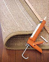 Slip Proof Rug -Acrylic latex caulk on the bottom of rug -You can also try out Latex Rug Gripper Tape, or a thin rug pad