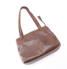 Chanel Leather Dark Brown Tote Bag. Get one of the hottest styles of the season! The Chanel Leather Dark Brown Tote Bag is a top 10 member favorite on Tradesy. Save on yours before they're sold out!