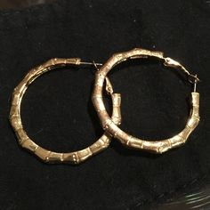 Kate Spade gold bamboo hoop earrings Gold Kate Spade hoop bamboo earrings. In perfect condition, only worn a couple of times. Love 'em but don't need 'em anymore. No trades. kate spade Jewelry Earrings
