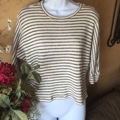 20% OFF 2+ Sanctuary stripe knit top Super cute comfy knit top by designer sanctuary clothing. Cream with gray stripe and a touch of metallic thread. Perfect layered over your favorite T-shirt or tank. Fabric is 90% cotton 10% polyester machine wash cold water. Sanctuary Tops Tunics