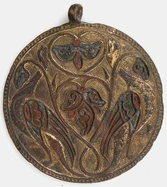 Pendant Medallion    Date:ca. 1180–90  Geography:Made in Limoges, France  Culture:French  Medium:Copper: engraved, stamped, and gilt; champlevé enamel: traces of medium and light blue, light green, and red  Similar medallions have been excavated in Spain as well as in England.