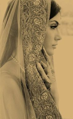Im hesitant on wearing a veil, but I love the thick, embroidered borders against the sleek hair. Its such a beautiful contrast.