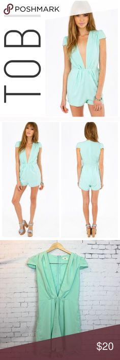"🍉 TOBI Romper Pretty and sexy romper with a plunging neckline and cap sleeves from TOBI in a beautiful sea foam aqua color. Size Small. Approx 29"" long and 16"" across the chest when laying flat. Excellent condition. Tobi Pants Jumpsuits & Rompers"