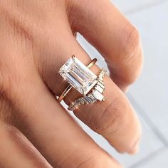 Line by Line ✨ This version of our signature Aura ring features a gorgeous emerald cut moissanite set in gold. Emerald Cut Rings, Emerald Cut Wedding Band, Diamond Rings, Emerald Cut Moissanite, Wedding Jewelry, Wedding Rings, Gold Engagement Rings, Halo Engagement, Dream Ring