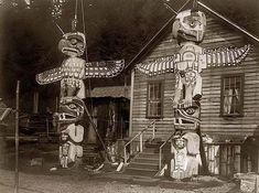 You are looking at an intriguing picture of Carved Posts Alert Bay. It was taken in 1914 by Edward S. Curtis.    The picture presents Two totem poles in front of a wood frame house in the Nimkish (Namgis) village Yilis (Yalis) , on Cormorant Island. Totem pole depicts an eagle representing the owner's paternal crest and a grizzly bear symbolizing the maternal one.    We have created this collection of pictures primarily to serve as an easy to access educational tool.
