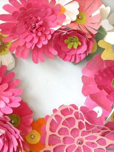 @DeLynne Good  cut! cut! paper flowers made into wreathes, could be tiered and hung over head in blues/greens/browns,