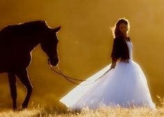 """Here I am on the way to """"the ball"""" with my flowing gown and black stallion named Lightning."""