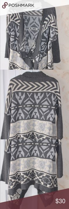 Francesca's Aztec printed Sweater Beautiful grey, blue and white Aztec printed sweater from Francesca's collection. Brand is Trendology. Like new condition with open front. Tight fit at end of arms. 55% Ramie, 45% cotton. Francesca's Collections Sweaters