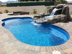 """The Leisure Pools """"Eclipse"""" composite fiberglass swimming pool offers a luxurious Splash Deck, ample entry/ exit steps and a deep end swimout bench. (You can add the waterfall!) Call us to schedule your installation at (855) 85-SPLASH."""