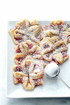 These Raspberry Jam Filled Puff Pastries are super easy homemade Christmas treats! Delicious holiday pastries filled with raspberry jam, and shaped into edible Christmas gifts! #christmas #christmascookies #pastries Puff Pastry Desserts, Frozen Puff Pastry, Puff Pastry Recipes, Cookie Desserts, Homemade Christmas Treats, Christmas Gifts, Christmas Cookies, Desserts To Make, Food To Make