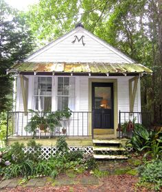 Fairhope Supply Co.: Cozy Telegraph Cottage, love the tattered tin roof with big simple brackets