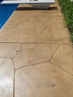 Ashlar Slate Stamped Pool Deck With Lanon Stone Color And