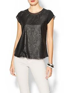 Really cute vegan leather top with cut outs.