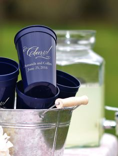 Personalize your wedding drink station, beverage center or reception bar with personalized plastic wedding cups, tumblers, and clear plastic party glasses custom printed a design, the bride and groom's names, and date. Guests will love taking them home as wedding giveaway favors to remember your wedding day. These cups can be ordered at http://myweddingreceptionideas.com/personalized_cups.asp