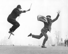 A policeman on a pogo stick chases a criminal who is carrying a bag of loot Stop Thief!, date unknown  Russell himself poses as the policeman in this shot. 'I had a pogo stick for years,' he told the Evening Standard in 2010. 'In fact, I became quite agile on it. I could travel great distances around the streets, often taking photographs while I was doing it'