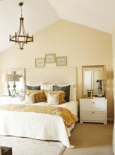 vaulted ceiling with a chandelier make the master look more grand than a regular bedroom 6th Street Design School: Feature Friday: Charming in Charlotte
