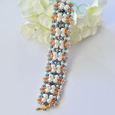 final look of the white pearl and 2-hole seed bead flower bracelet