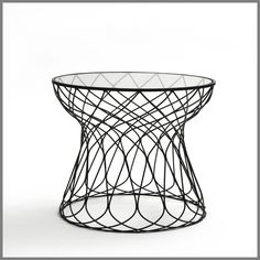 Add a touch of the Riviera to your courtyard or terrace with the Capri Collection of wire framed furniture. Its open weave and stylish profile are available in either black or white powder coat.