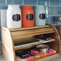 Turn a bread box into a charging station for mobile phones and tablets - hide all the electric cords by drilling holes in the back for snaking cords through.